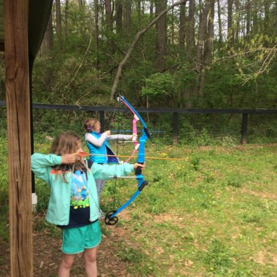 Sports and outdoor games: Archery.